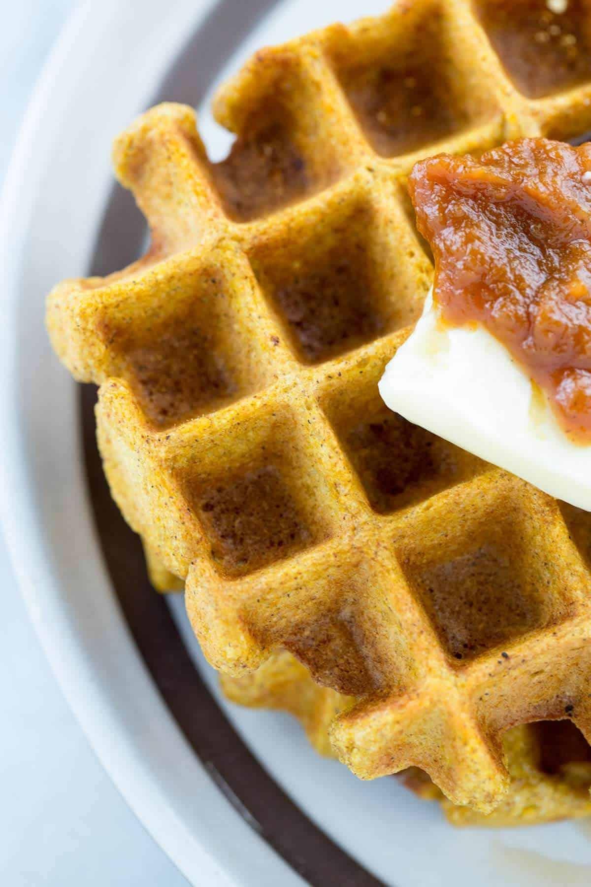 Buttermilk Pumpkin Spice Waffles - Fresh baked waffle with butter patty and pumpkin spread | jessicagavin.com