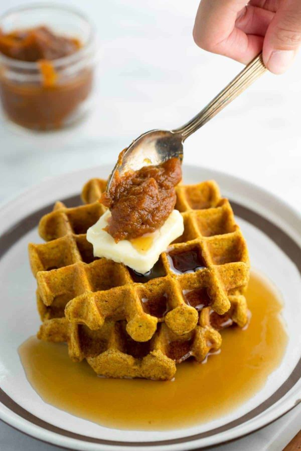 Stack of waffles with pumpkin butter spread on top