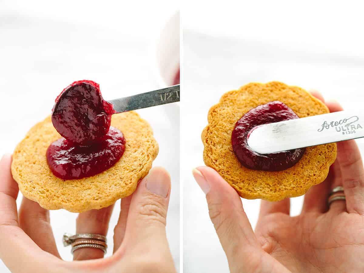 Step by step process of spreading homemade cranberry jam onto Linzer cookies | jessicagavin.com