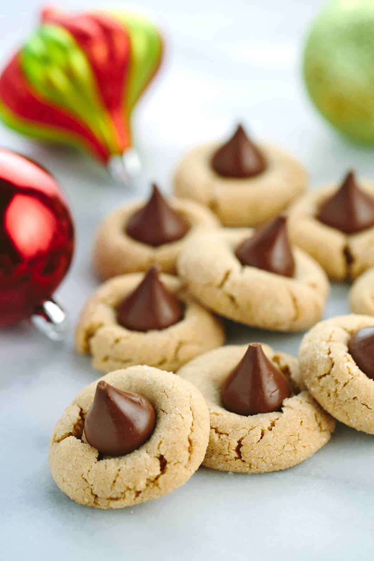 Classic Peanut Butter Kiss Cookies - a classic holiday tradition that everyone loves. Creamy peanut butter cookies are made special with milk Hershey's chocolate center. | jessicagavin.com