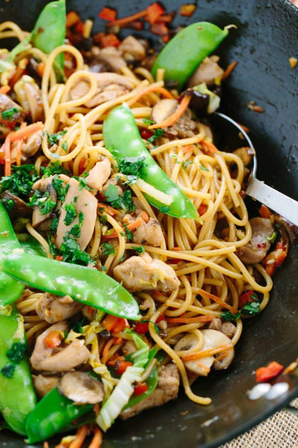 Stir-fried garlic noodles served with tender pieces of chicken and healthy vegetables