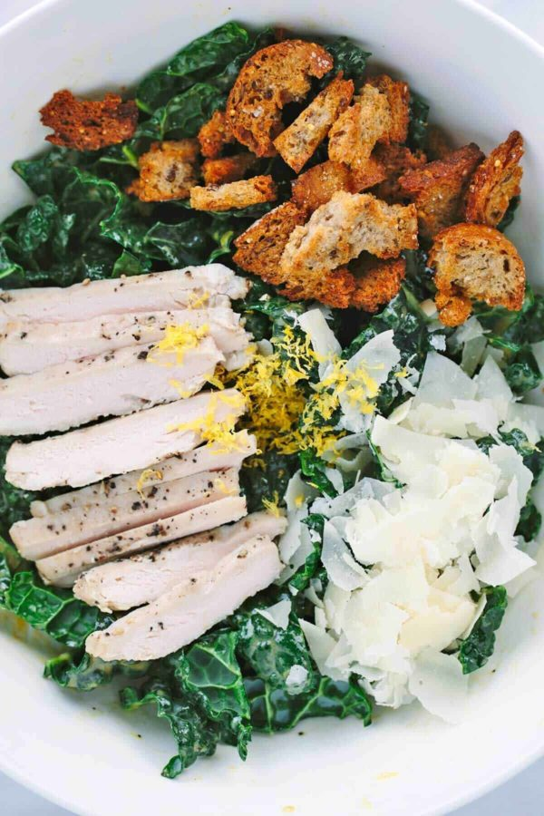 bowl of unmixed salad ingredients