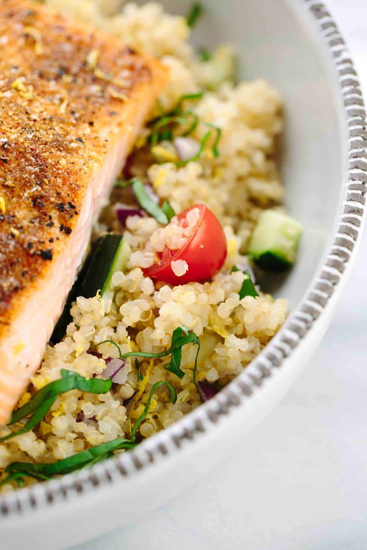 Mediterranean Spiced Salmon and Vegetable Quinoa - This healthy recipe is packed with protein packed! Earthy spices roasted lemons and fresh vegetables in each bite. | jessicagavin.com