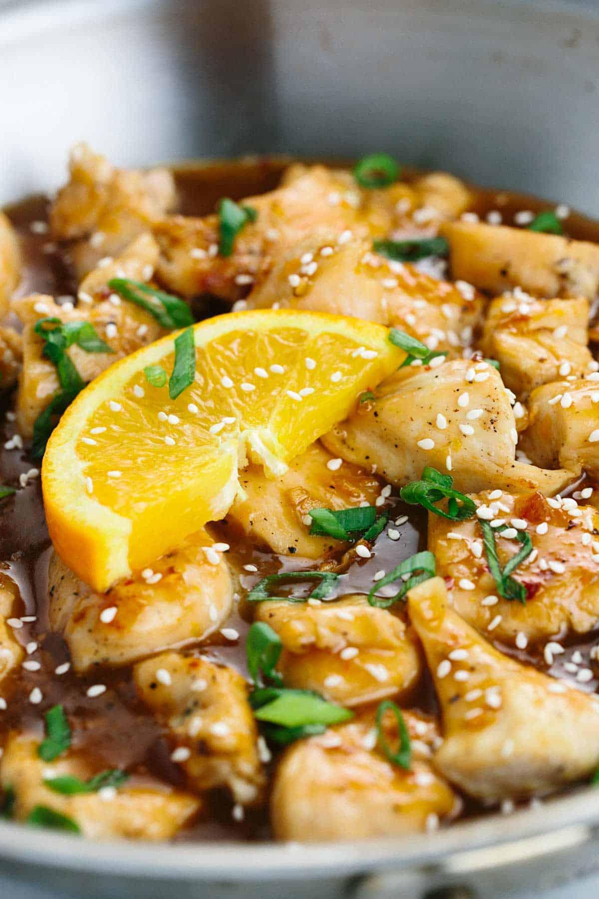 Healthier one pan chinese orange chicken recipe jessica gavin slice of orange sitting on top of chicken with sesame seeds in a pan forumfinder Gallery