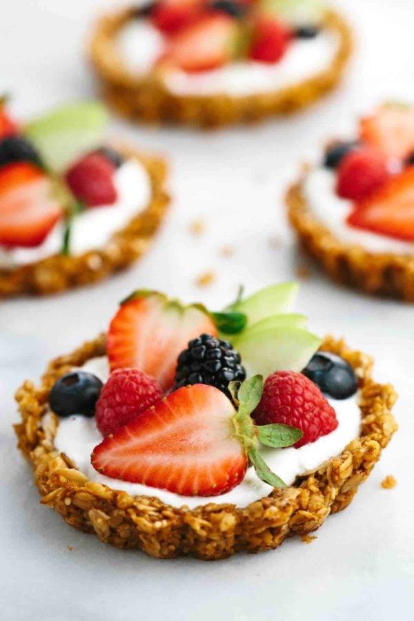 Breakfast fruit tart with granola crust and yogurt filling