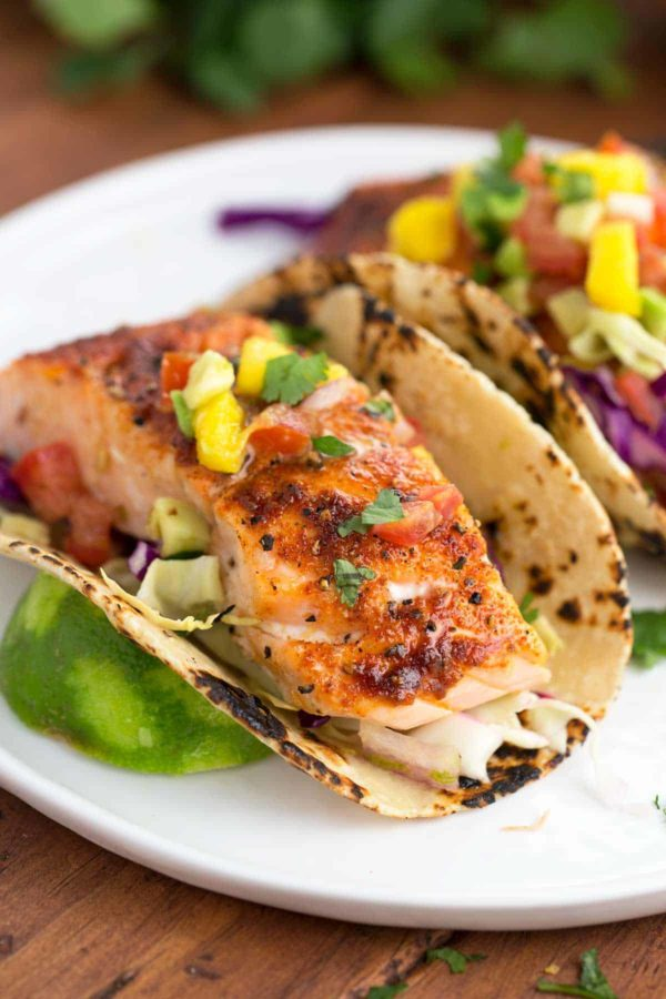 salmon tacos with maple chipotle seasoning and served with mango salsa