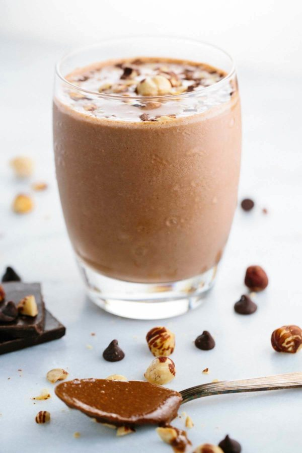 clear glass cup of chocolate hazelnut smoothie