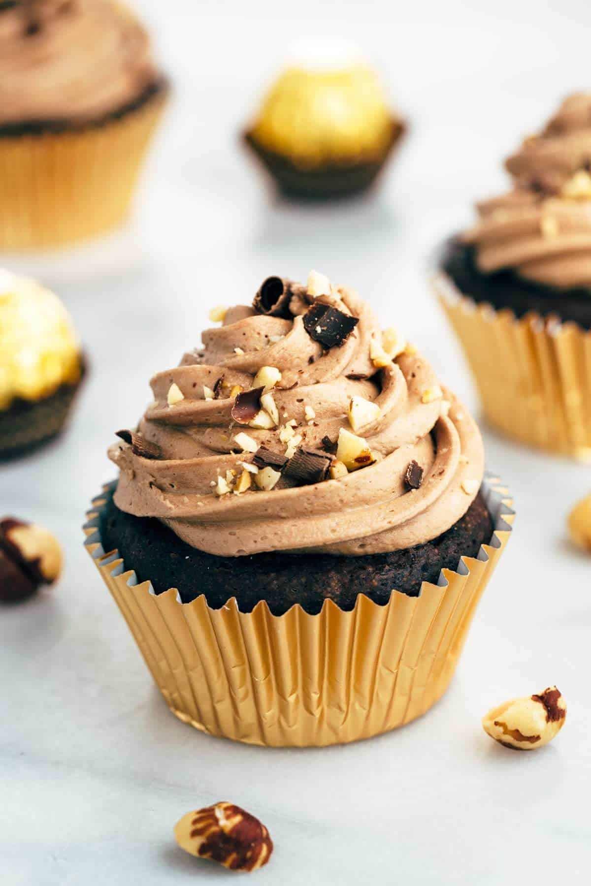 Ferrero Rocher inspired cupcakes with chocolate ganache filling and Nutella hazelnut buttercream | jessicagavin.com