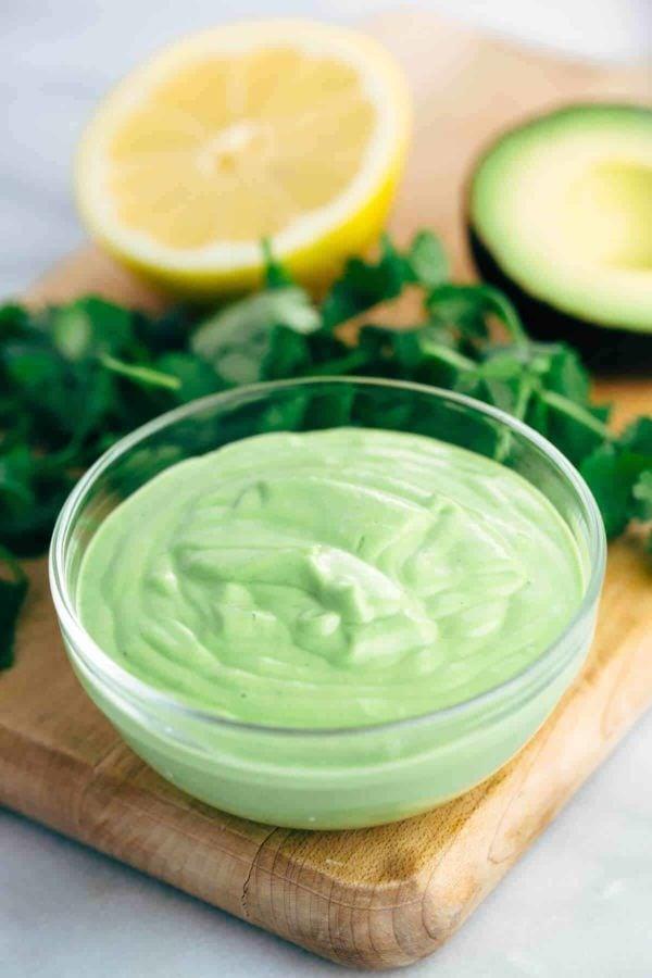 Creamy avocado sauce in a glass bowl