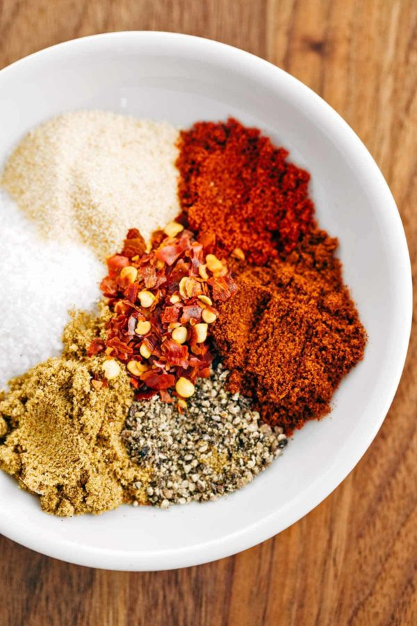 Dry rub steak spices such as cumin, chipotle, garlic, salt, and pepper