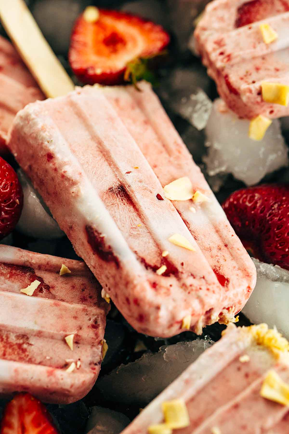 Vegan Strawberry Popsicles with Coconut - Only four simple ingredients for a refreshing and delicious frozen summertime treat! | www.jessicagavin.com