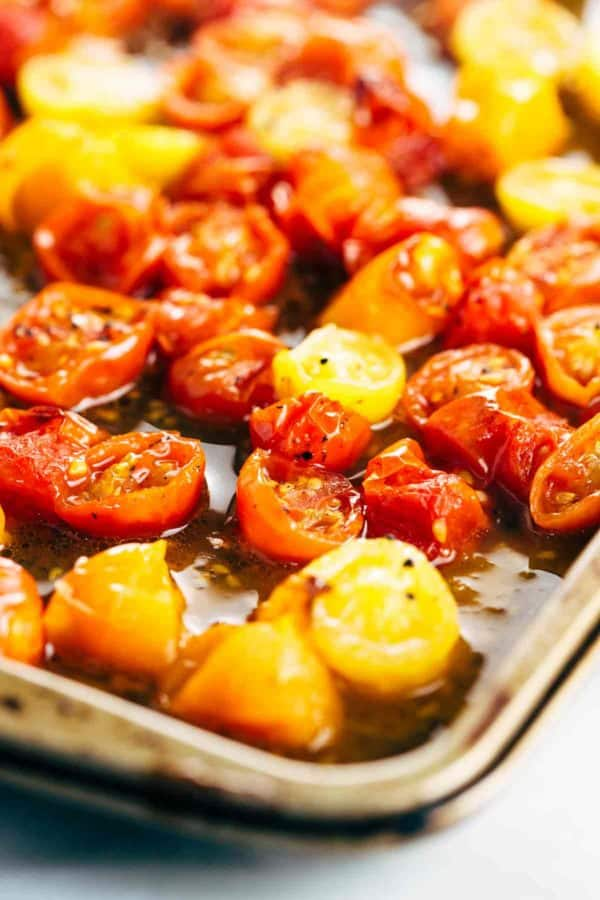 slices of roasted cherry tomatoes on a sheet pan