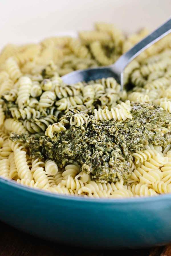 big pot of pasta with pesto sauce