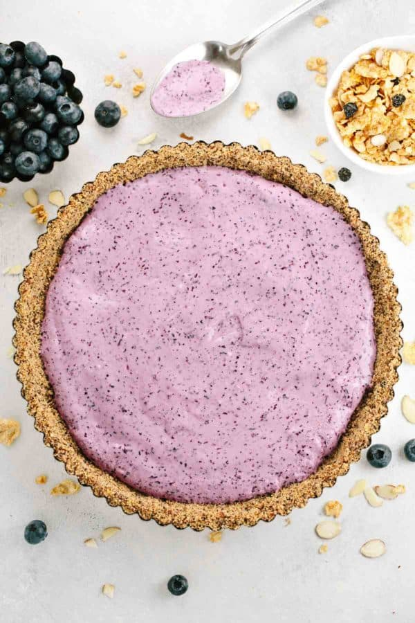 blueberry yogurt tart with a cereal and nut crust