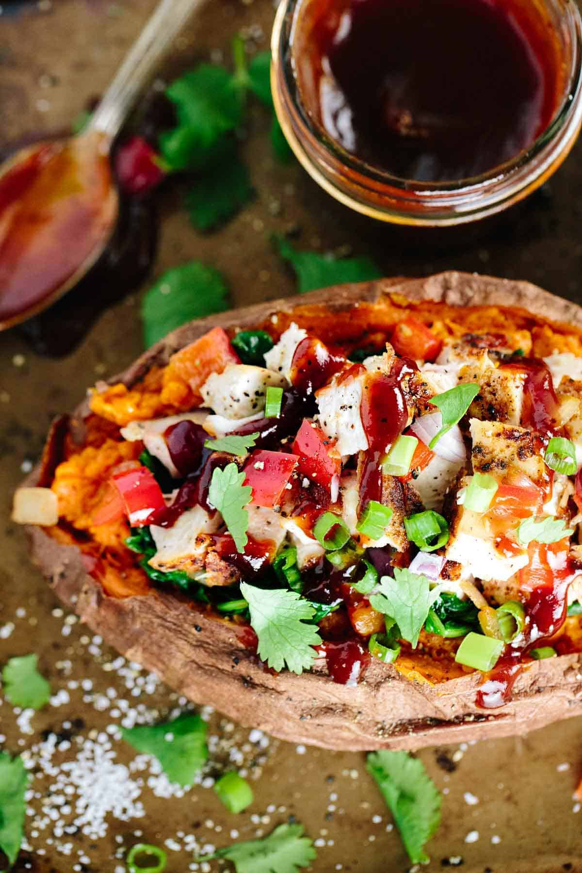 Stuffed Sweet Potato with Barbecue Chicken - Loaded with fresh kale, spinach, peppers and lean chicken for a simple and satisfying meal! | jessicagavin.com