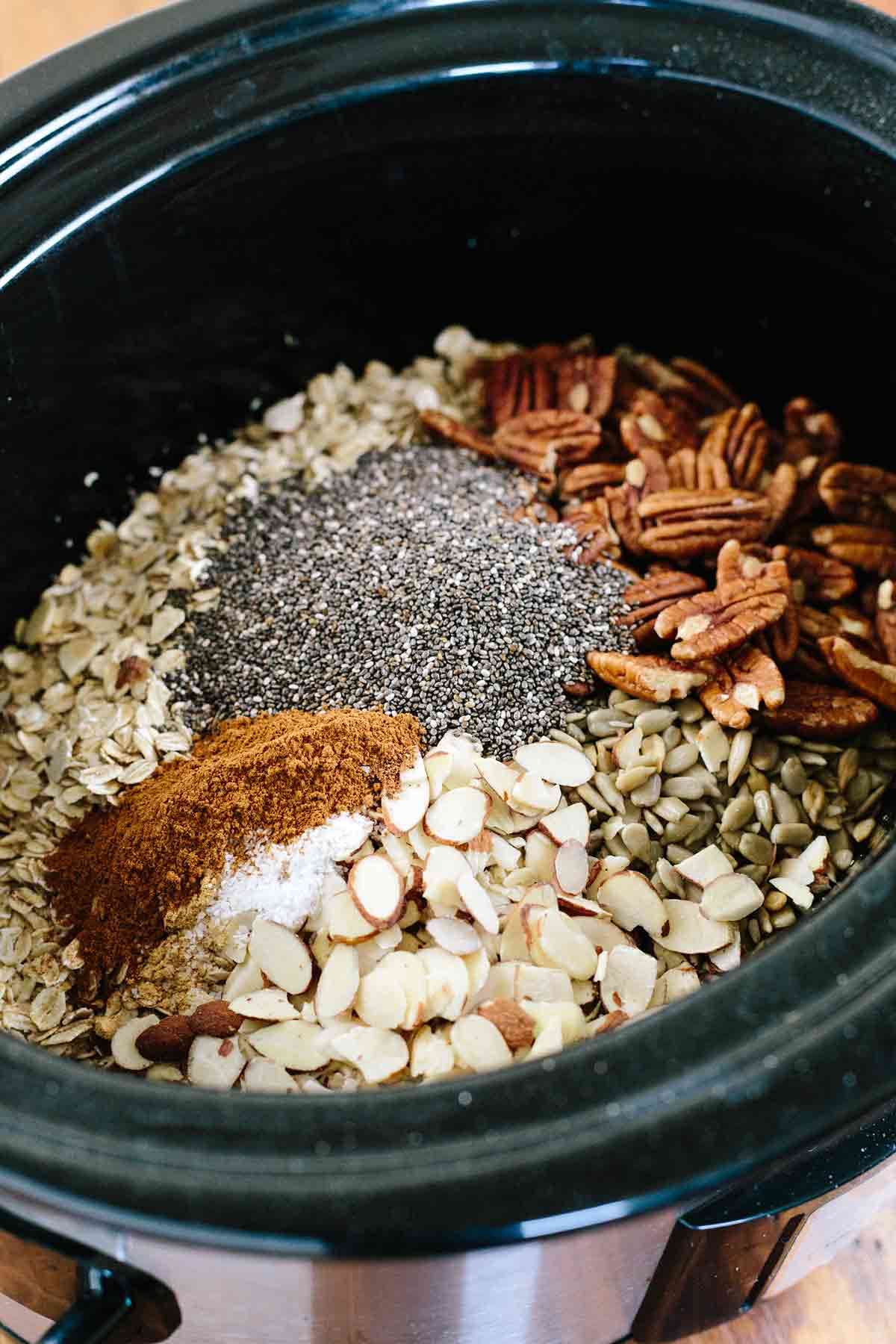 Crock Pot loaded with ingredients for homemade granola