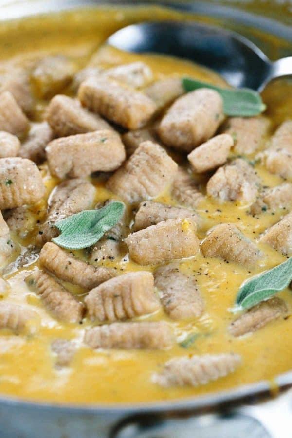 Gnocchi cooking in a pumpkin sage sauce