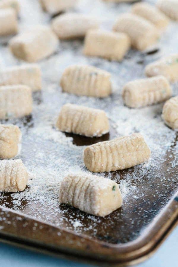 homemade gnocchi on a floured sheet pan