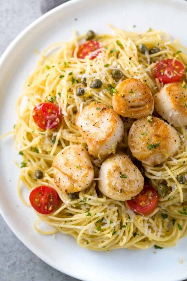 top down view of a plate of scallops and pasta