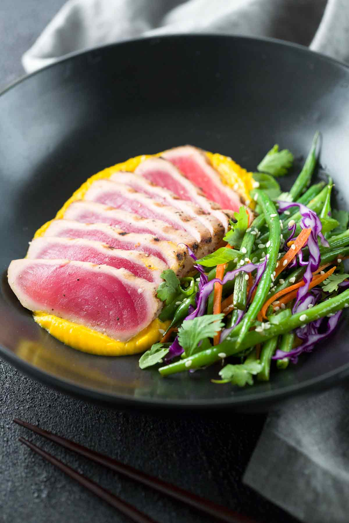 Seared Ahi Tuna with Crispy Sesame Green Beans - A gourmet recipe made right at home! Silky cauliflower carrot ginger puree adds a touch of elegance with ease. | jessicagavin.com