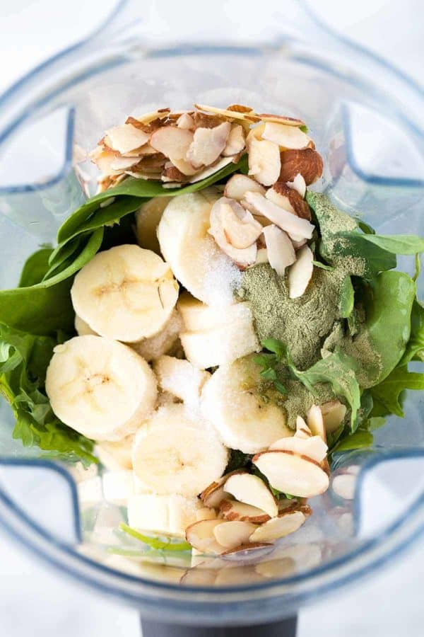 Vitamix container of bananas and spinach for a green smoothie