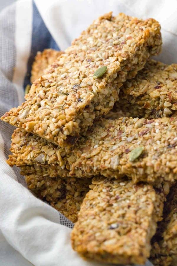 Baked Paleo Energy Bars - A mixture of ground nuts, seeds, and a touch of maple syrup for a healthy portable snack bar on the go! | jessicagavin.com