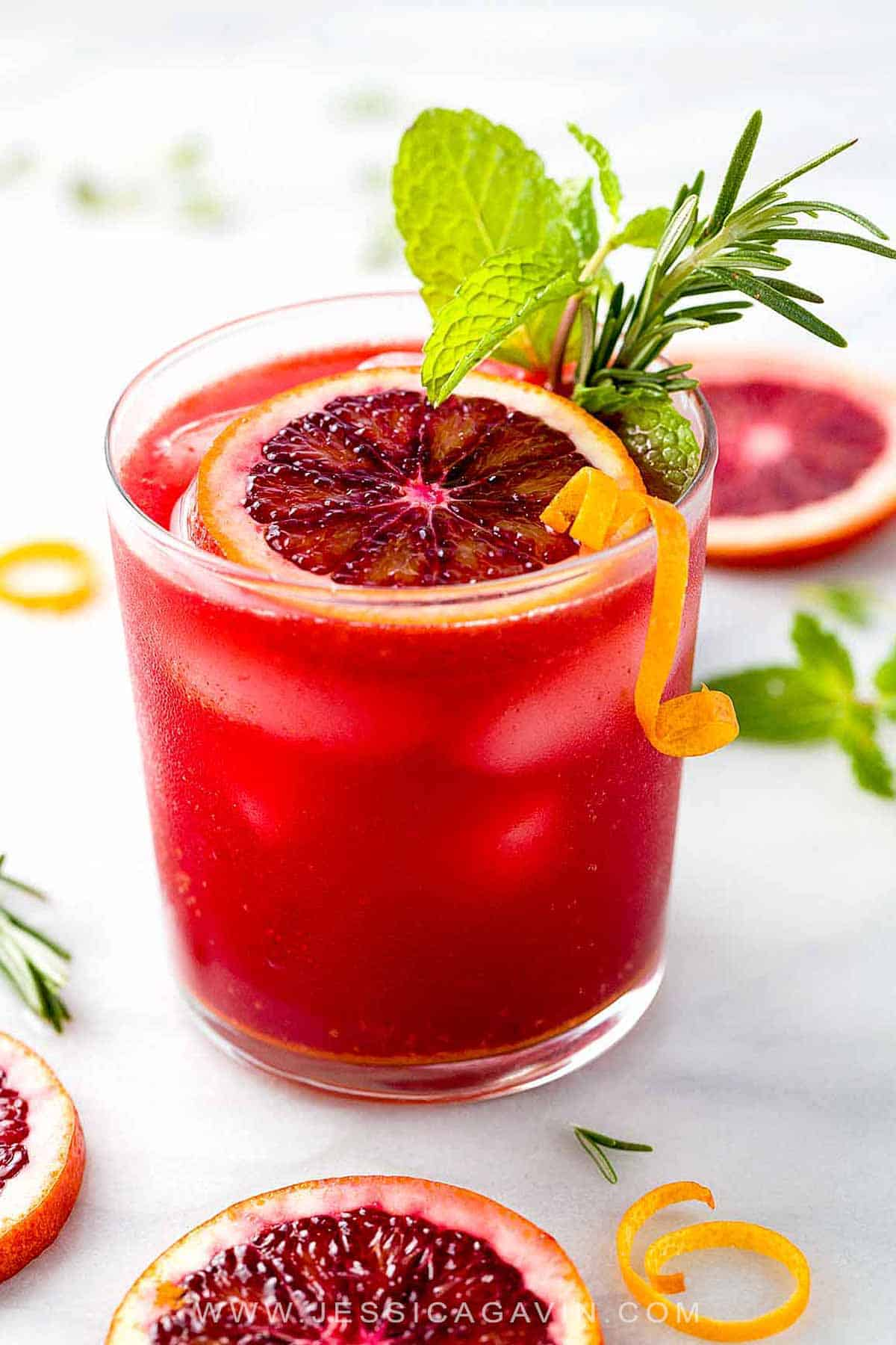 Sparkling Blood Orange Mocktail - A refreshing drink recipe packed with healthy nutrients! Each sip infuses turmeric, ginger, fresh squeezed juice, mint, and rosemary. #bloodorange #mocktail #cocktail #drink