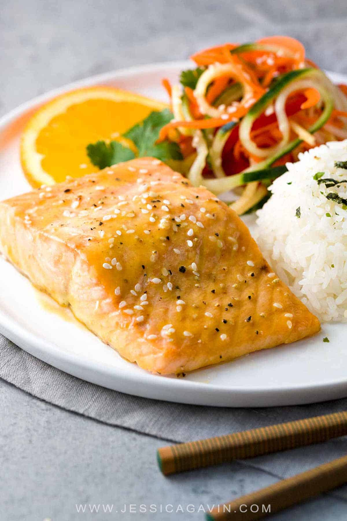 Pan Roasted Citrus-Soy Glazed Salmon - A quick and flavorful Asian-inspired recipe combining healthy protein and omega-3 fatty acids. Served with a crunchy and refreshing cucumber and vegetable salad.  #salmonrecipes #roastedsalmon #fishrecipes #healthyrecipes