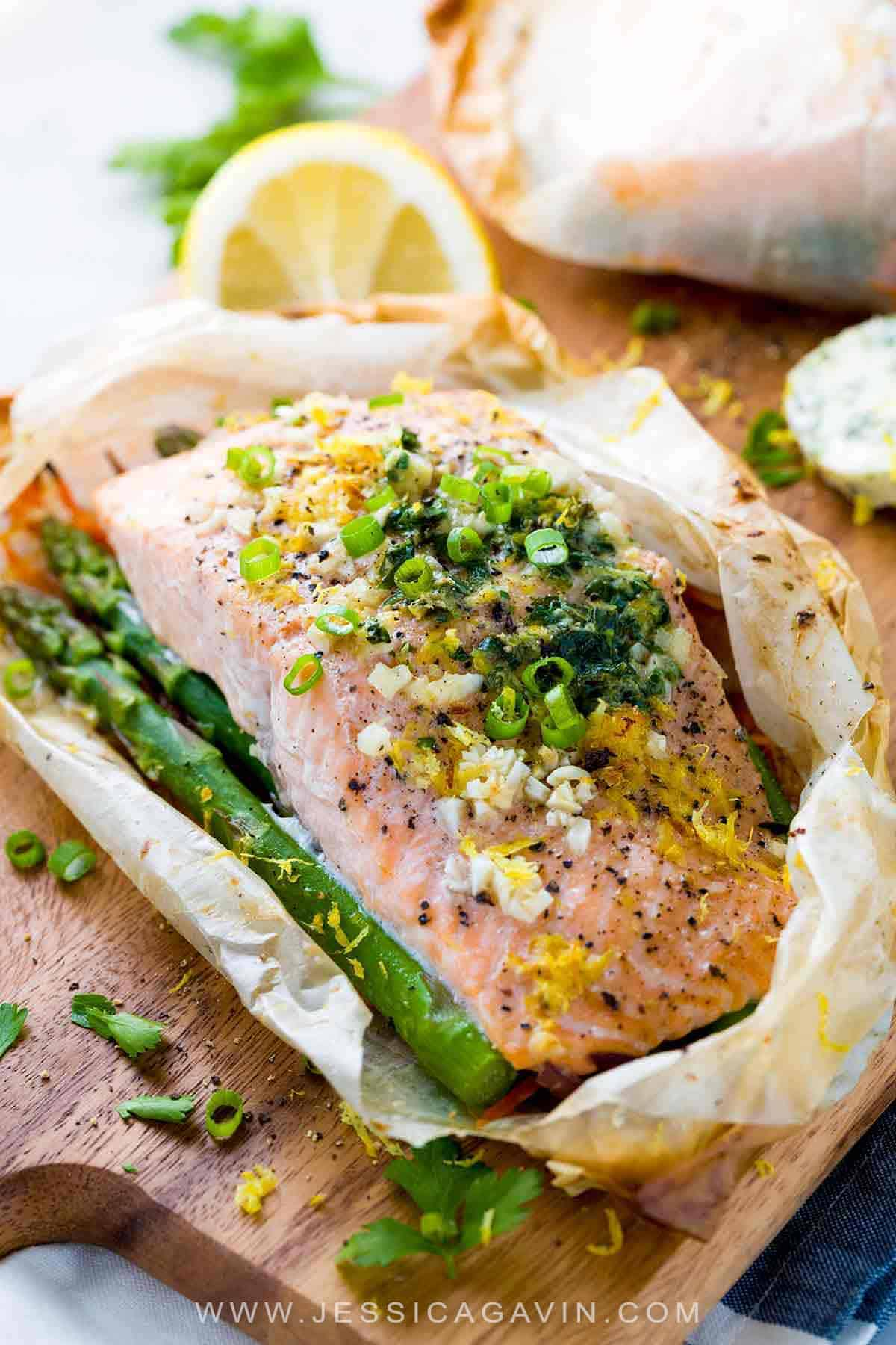 Salmon En Papillote - Fillets placed on a bed of vegetables, wrapped in a parchment paper pouch and baked in the oven. #salmonrecipes #frenchrecipes #fish #papillote