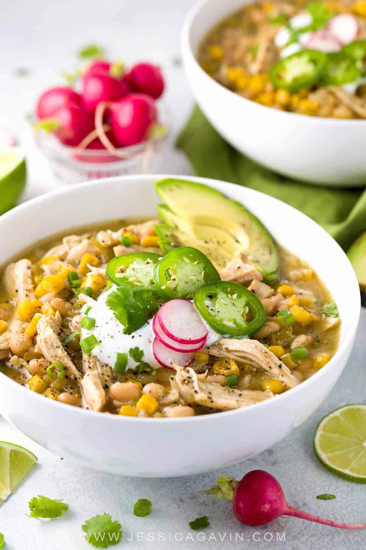 White bean chicken chili simmered in a crockpot with whole roasted jalapenos, tender beans, corn, and lean chicken breast. A healthy recipe pack with flavor and spice. #slowcooker #crockpot #instantpot #chili #chickenchili