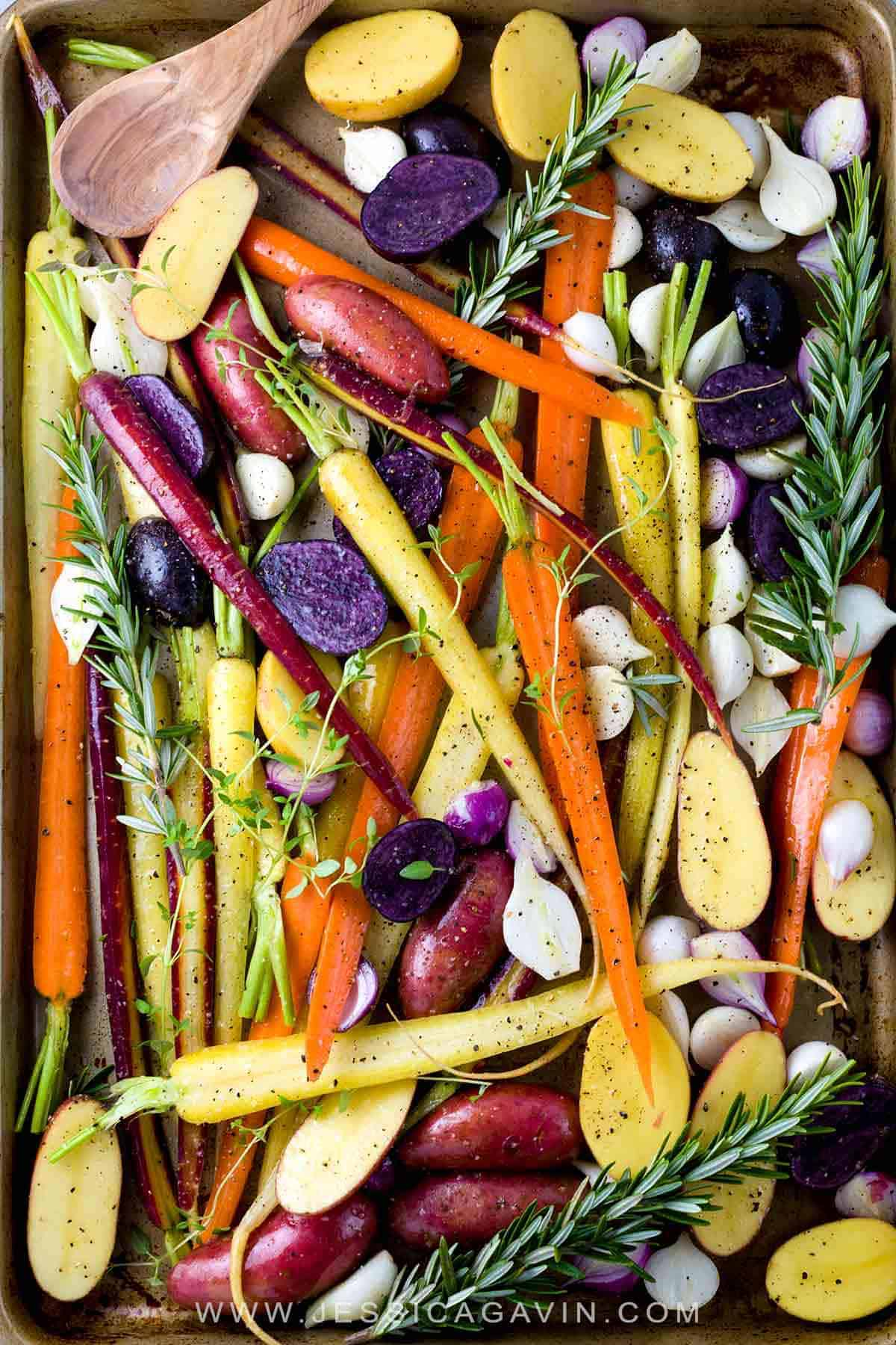 Oven Roasted Root Vegetables Recipe - A colorful assortment of seasonal ingredients like potatoes, carrots, and onions. A healthy recipe served with a creamy homemade yogurt ranch sauce! #rootvegetables #roastedvegetables #veggies #vegetablerecipe #vegetarian