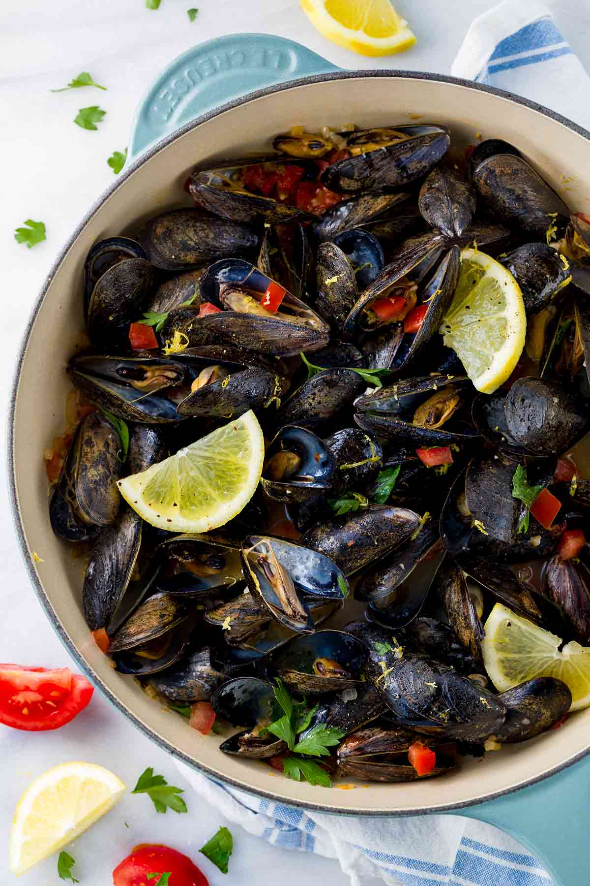 Steamed mussels with white wine and garlic is an easy one-pot meal ready in 20 minutes! Aromatic vegetables are cooked with fresh mussels for a light appetizer or meal.