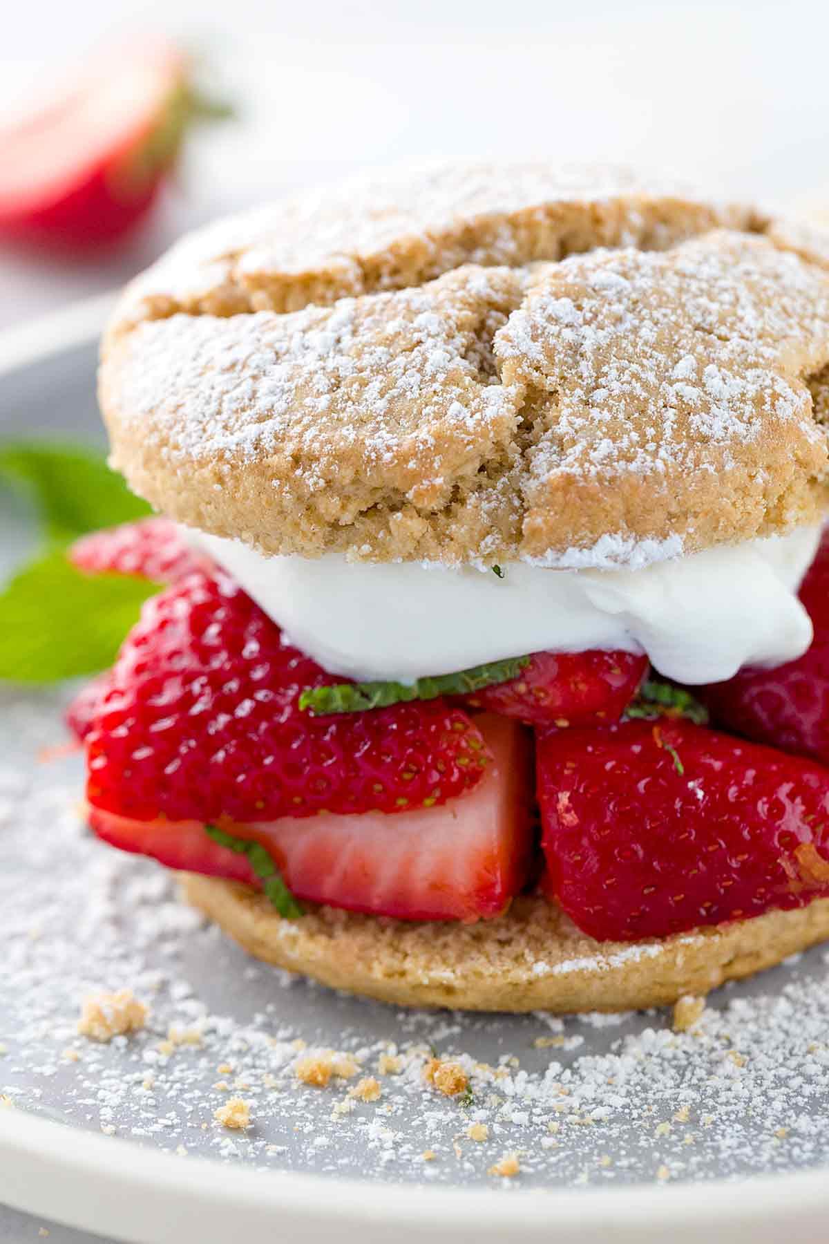 Strawberry shortcake sandwich dusted in powdered sugar