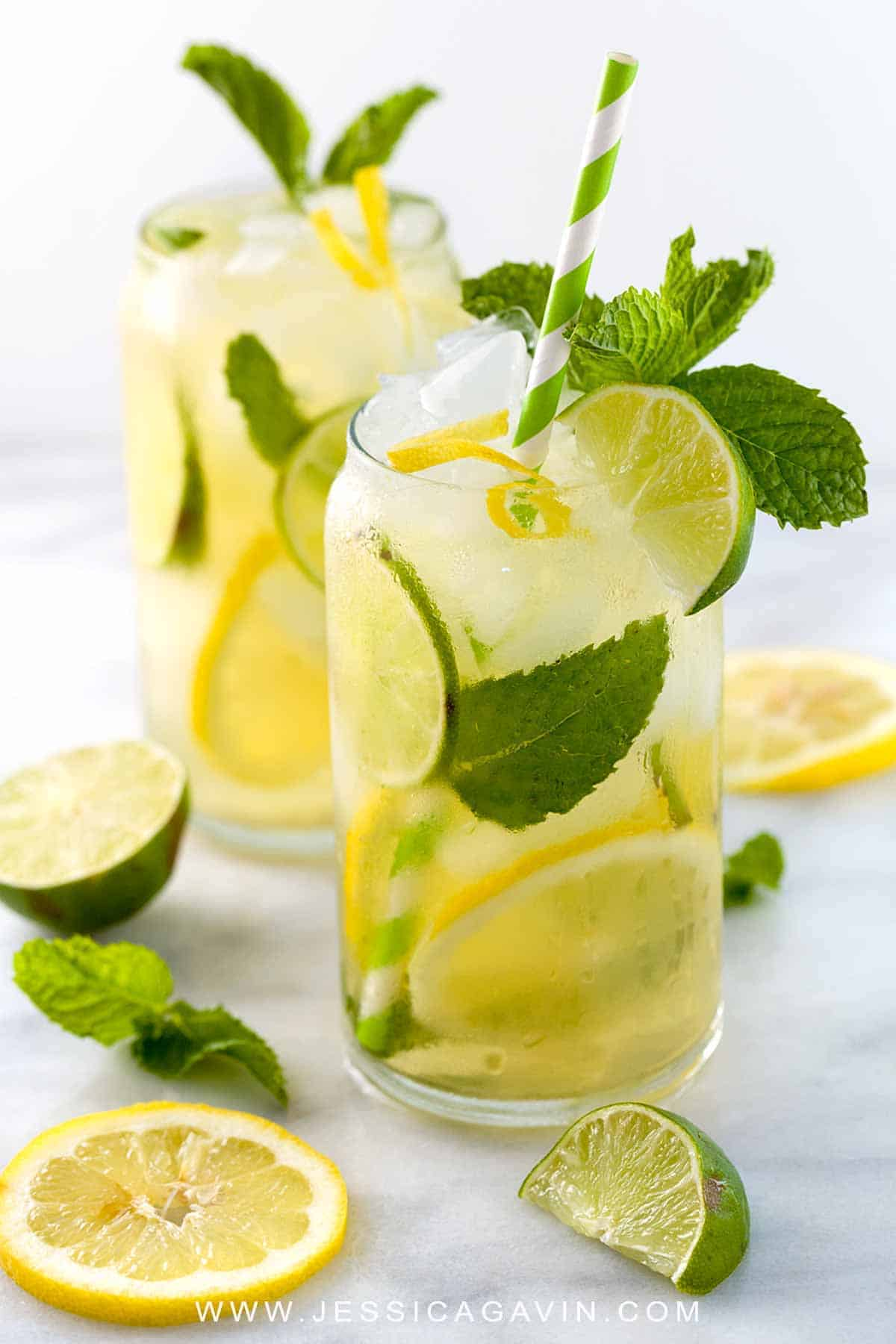 Iced green tea with lemon, lime, and fresh mint is a refreshing and revitalizing beverage for those warm days. Each glass is naturally sweetened with honey and packed with antioxidants. #icedtea #lemonlime #drink #greentea
