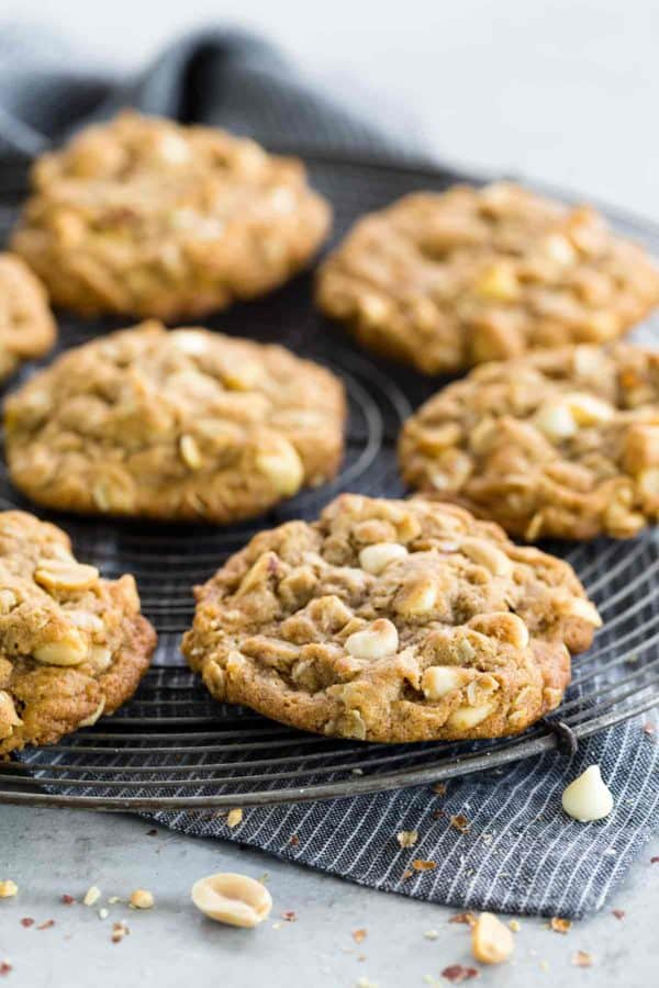 Several oatmeal cookies cooling on a rack