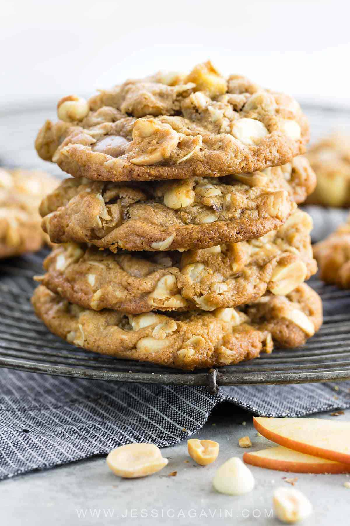 Apple oatmeal cookies will certainly satisfy your snack cravings this holiday season. This delicious recipe is made using fresh Fuji apples, whole wheat flour, peanuts, white chocolate chips and a little bit of cinnamon for a tasty combination. #cookies #oatmealcookies #applecookies #sweets