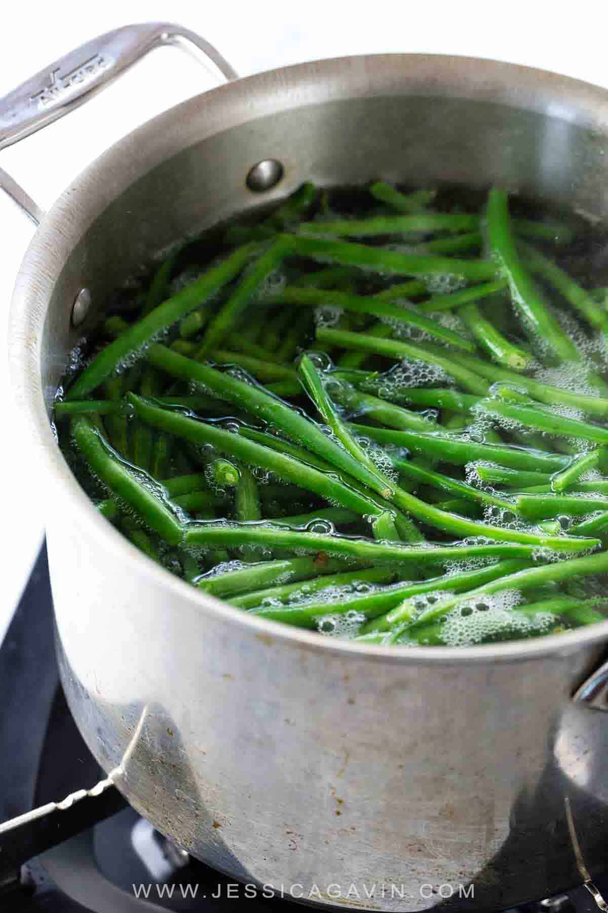 Learn how to cook green beans to achieve the perfect texture and color every time. The blanch and shock method is the key to bright and crunchy beans. #greenbeans #howtocook #cooking #foodscience
