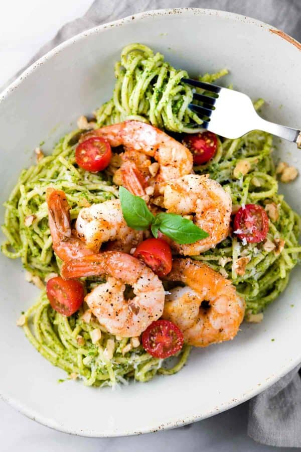 shrimp and pesto pasta in a bowl