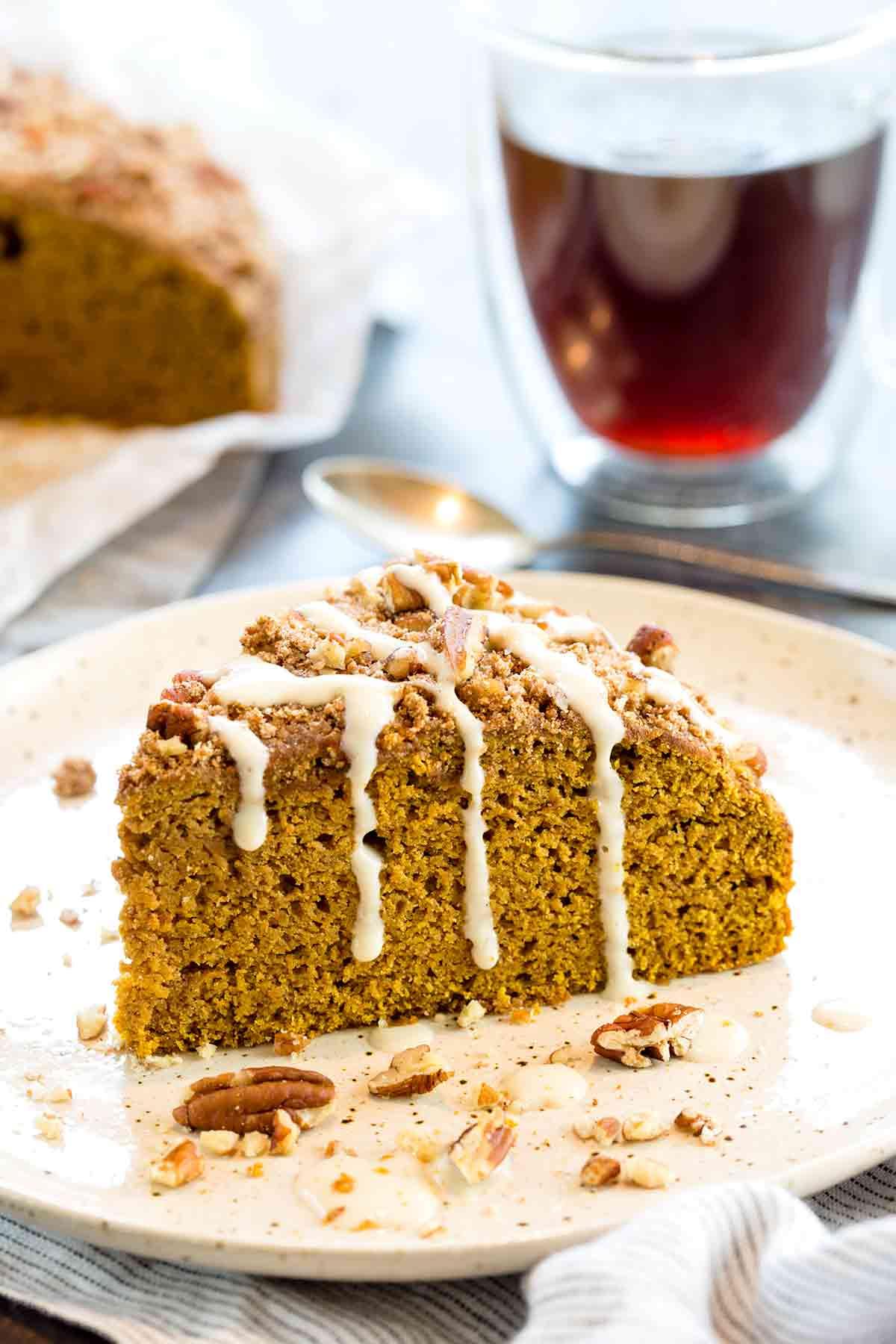 Slice of pumpkin coffee cake with vanilla yogurt drizzled on top