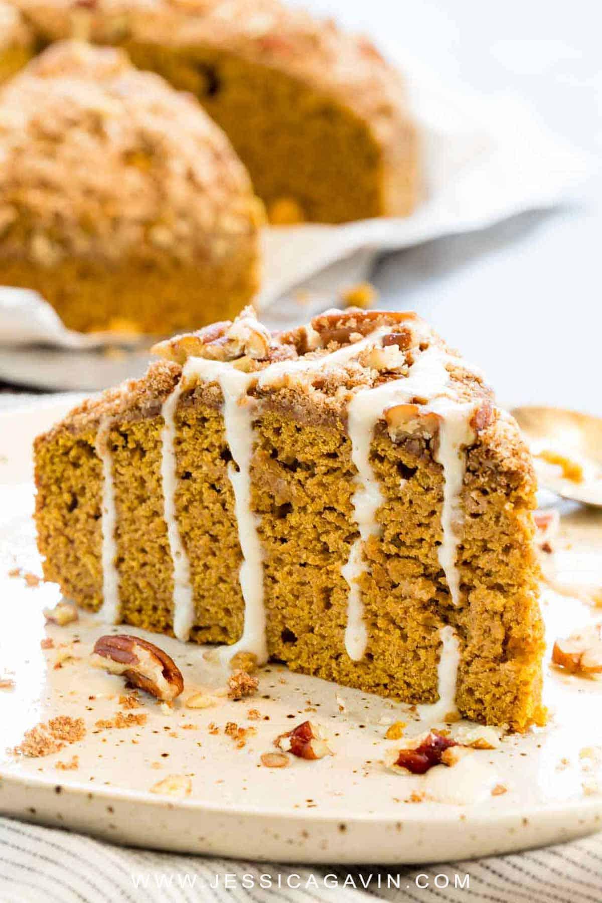 Lightened up pumpkin coffee cake is an easy breakfast treat tofeed a crowd! Each slice packs whole grains, cinnamon, pecans, and pumpkin flavor. #coffecake #breakfast #sweets #pumpkin #fallrecipes