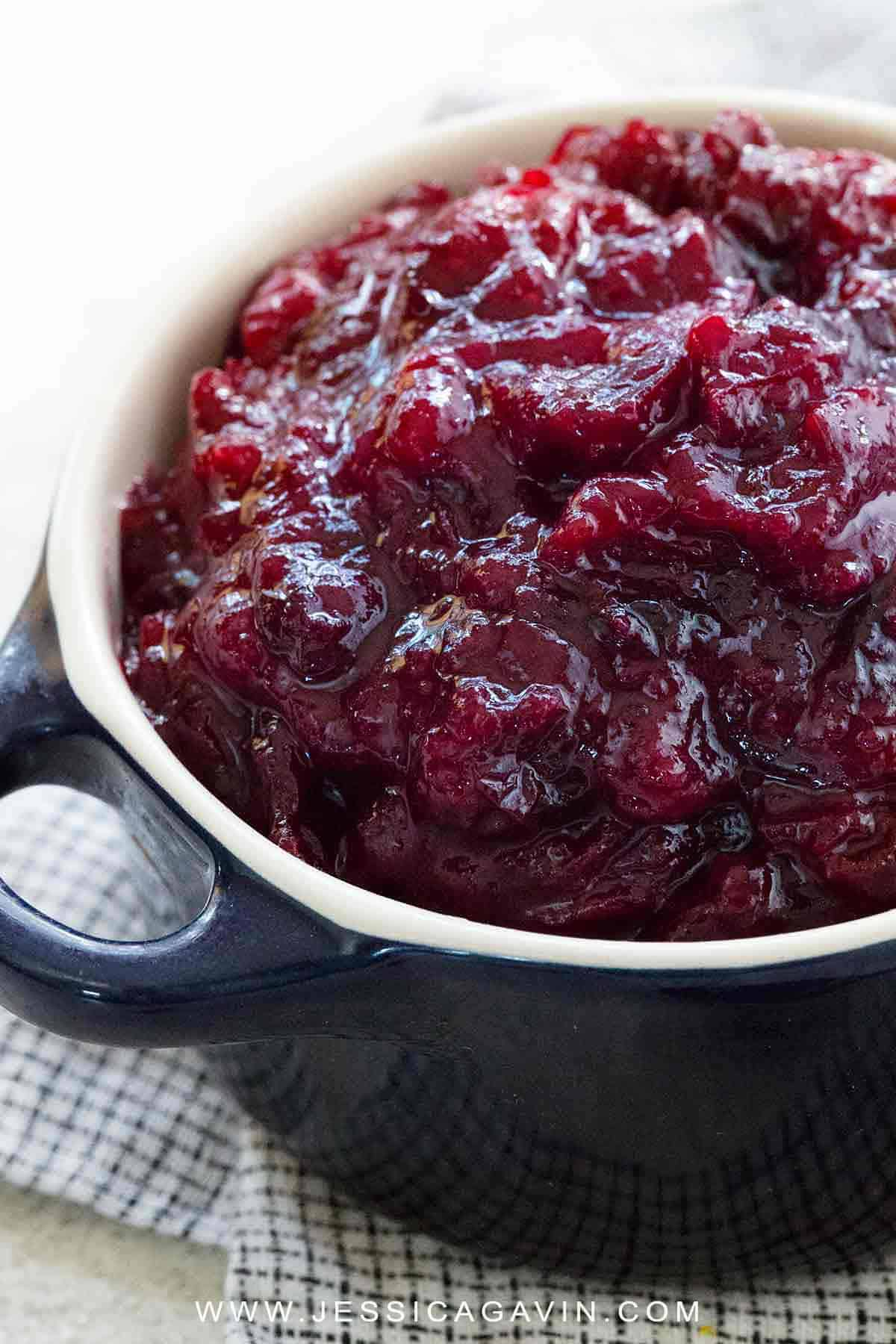 A Thanksgiving holiday feast is not complete unless there is homemade cranberry sauce on the table! Make this easy four-ingredient condiment ready in under 30 minutes. #thanksgiving #cranberrysauce #cooking #cranberry #vegan