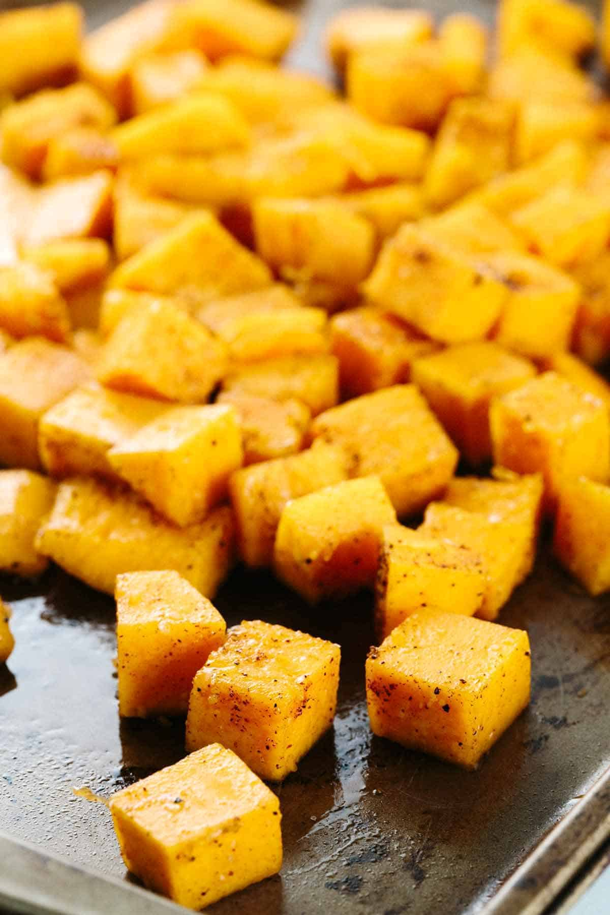 A baking sheet with cubes of butternut squash