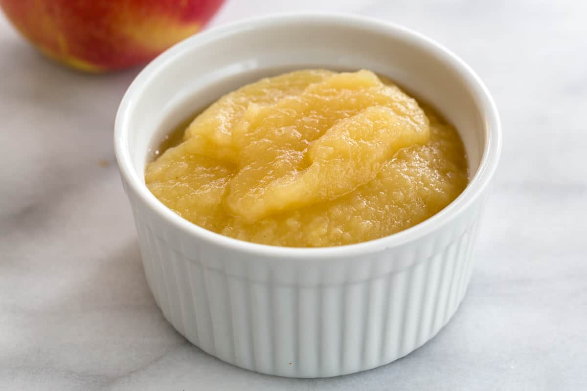 Apple sauce puree in a white cup