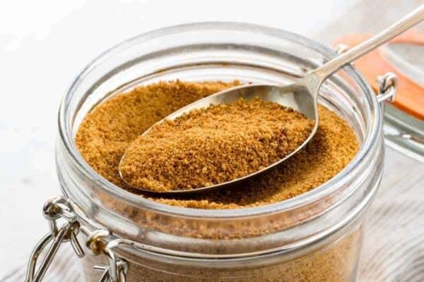 Jar of brown coconut sugar with a spoon