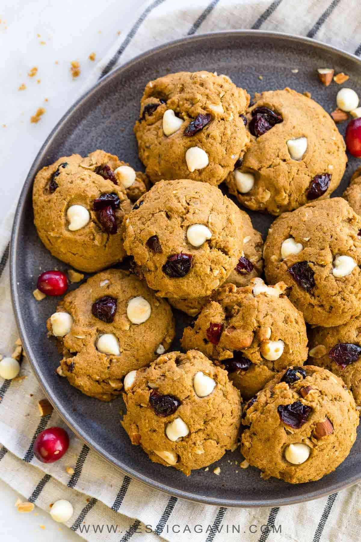Gluten-free persimmon cookies with cranberries, white chocolate chips, and almonds. A delicious treat for everyone, even those with a gluten sensitivity. #glutenfree #cookies #baking #persimmons