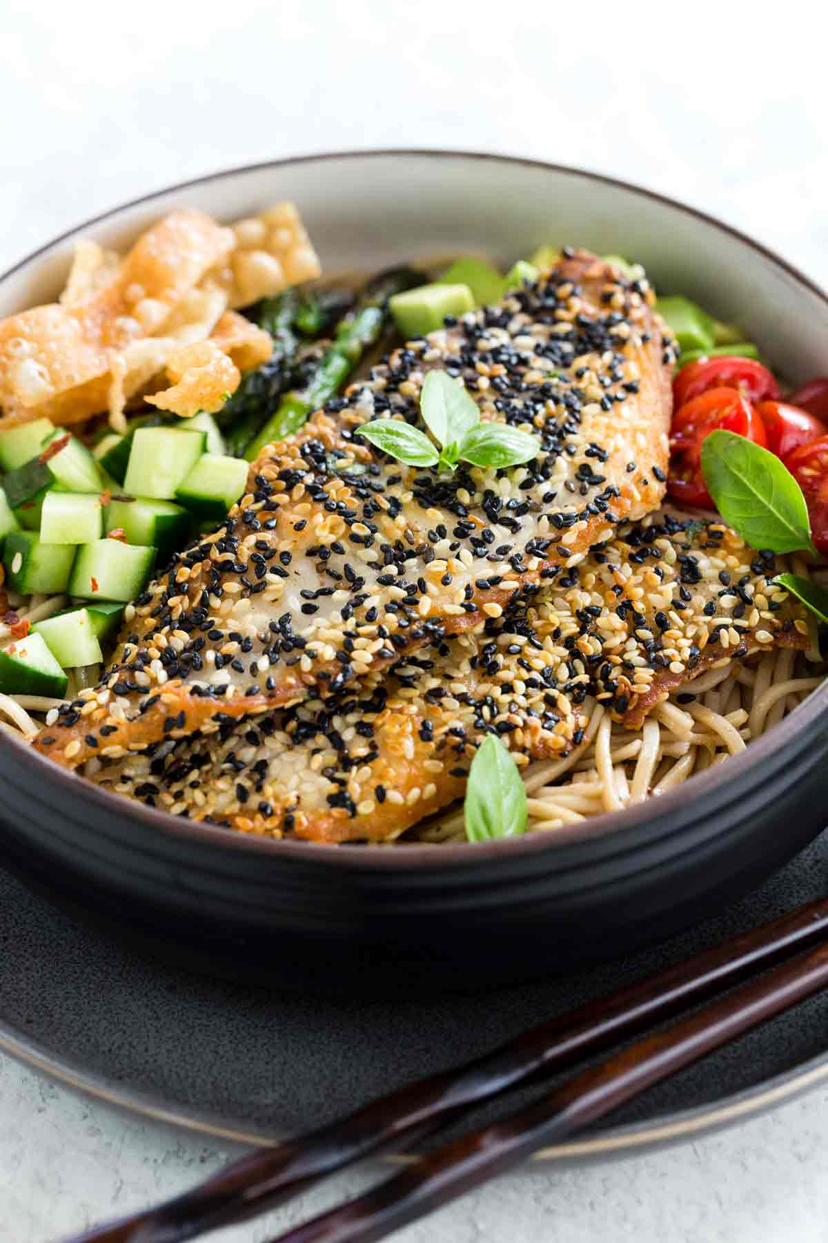 Pan-fried tilapia with sesame crust is an Asian-inspired dish packed with bold flavors and irresistible textures.
