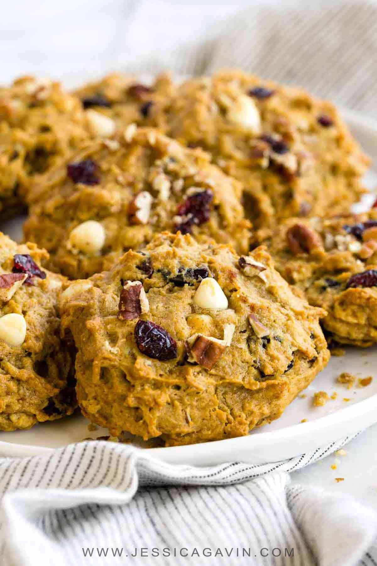 A sweet and spiced persimmon cookies recipe with cranberries, white chocolate chips, and pecans. A perfect soft and moist treat to make during the holidays! #persimmoncookie #cookies #persimmon #fallrecipes