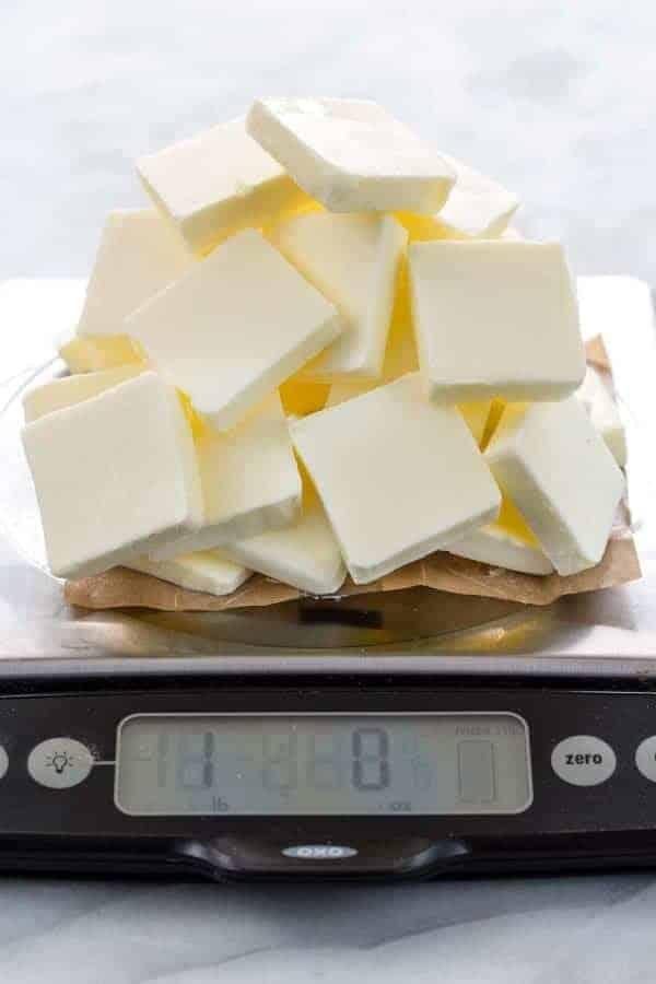 Slices of butter stacked on a scale