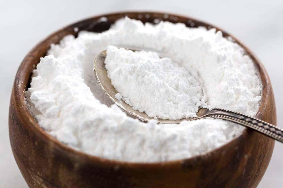 Jar of powdered sugar with a spoon