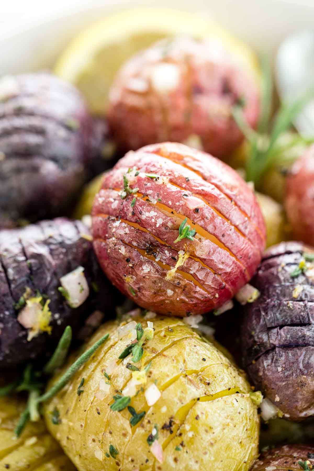 Closeup photo of seasoned Hasselback potatoes showing slices